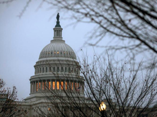 The Capitol is seen in Washington, early Tuesday, Dec. 5, 2017, days before a budget clash could produce a partial government shutdown by the weekend unless there's an agreement on a measure temporarily keeping agencies open. President Donald Trump and congressional leaders have scheduled a meeting to sort out their differences over spending, immigration and other priorities. (AP Photo/J. Scott Applewhite)