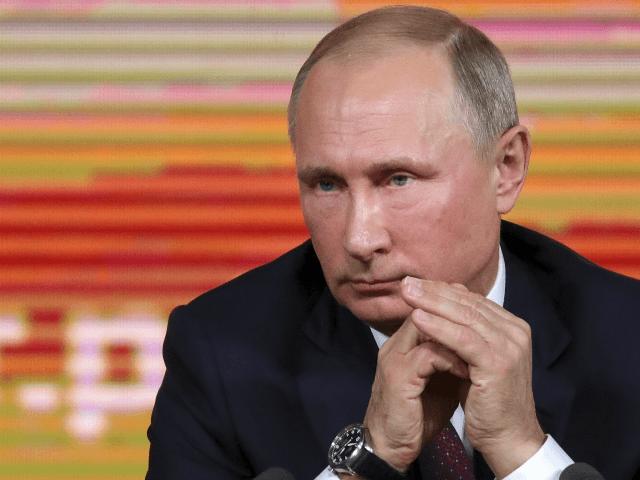 Russian President Vladimir Putin listens to a journalist's question during his annual news conference in Moscow, Russia, Thursday, Dec. 14, 2017. (Mikhail Klimentyev, Sputnik, Kremlin Pool Photo via AP)