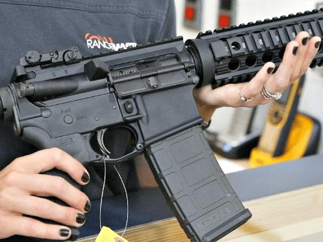 Woman Holds AR-15 Rifle