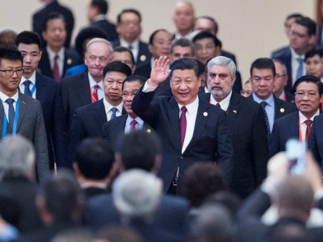 China's President Xi Jinping, centre, arrives with leaders at the opening ceremony of the CPC in dialogue with world political parties high-level meeting, at the Great Hall of the People on Friday Dec. 1, 2017. (Fred Dufour/Pool via AP)