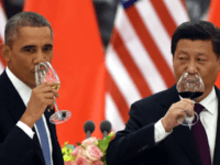 President Barack Obama and China's President Xi Jinping drink a toast at a lunch banquet in the Great Hall of the People in Beijing, Nov. 12, 2014. Presidents Obama and Xi jointly announced a landmark agreement Wednesday that includes new targets for carbon emissions reductions by the U.S. and a first-ever commitment by China to stop its emissions from growing by 2030.