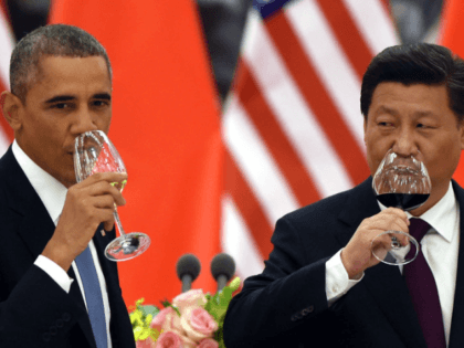 President Barack Obama and China's President Xi Jinping drink a toast at a lunch banquet in the Great Hall of the People in Beijing, Nov. 12, 2014. Presidents Obama and Xi jointly announced a landmark agreement Wednesday that includes new targets for carbon emissions reductions by the U.S. and a …