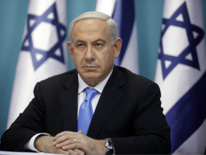 JERUSALEM, ISRAEL - NOVEMBER 21: (ISRAEL OUT) Prime Minister Benjamin Netanyahu looks on during a joint press conference with Foreign Minister Avigdor Liberman and Defence Minister Ehud Barak (not pictured), on November 21, 2012 in Jerusalem, Israel. An official ceasfire started at 9pm local time between Israel and the Palestinian …