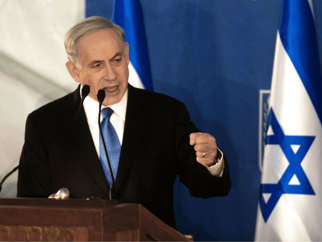 Israeli Prime Minister Benjamin Netanyahu delivers a speech during a swearing-in ceremony for Israel's new Chief of Staff Gadi Eisenkot at the Prime Minister's Jerusalem offices on February 16, 2015. AFP PHOTO / MENAHEM KAHANA (Photo credit should read MENAHEM KAHANA/AFP/Getty Images)