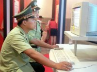 BEIJING, CHINA: Chinese policemen surf the Internet at a computer fair in Beijing, 21 August 2000. China has recently arrested a high school teacher in the southwestern province of Sichuan for posting articles critical of the communist authorities on the Internet, a charge that carries a prison term of up …