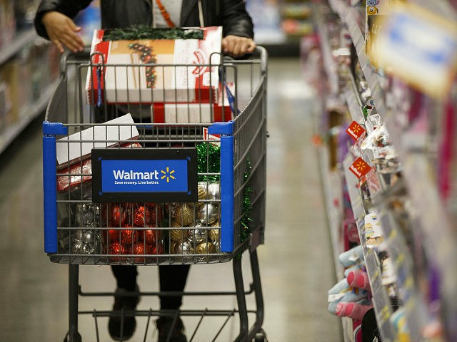A customer pushes a shopping cart at a Wal-Mart Stores Inc. location in Burbank, California, U.S., on Tuesday, Nov. 22, 2016. Consumer hardline retailers are hopeful Black Friday will provide a strong start to the holiday shopping season, but any lift may come at the expense of margins, as the landscape has become increasingly promotional. Photographer: Patrick T. Fallon/Bloomberg via Getty Images