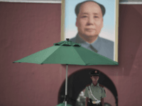 A Chinese paramilitary guard stands in front of a portrait of late communist leader Mao Zedong at the Forbidden City in Beijing on July 31, 2017, on the eve of the 90th founding anniversary of the People's Liberation Army (PLA). The PLA, originally called the Chinese Workers' and Peasants' Red …