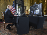 US-POLITICS-TRUMP US President Donald J. Trump participates in a video teleconference call with military members on Christmas Eve in Palm Beach, Florida on December 24, 2017. / AFP PHOTO / Nicholas Kamm (Photo credit should read NICHOLAS KAMM/AFP/Getty Images)