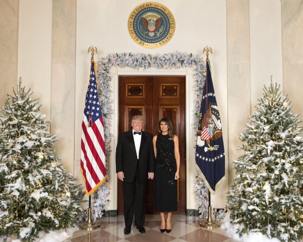 President Donald J Trump and First Lady Melania Trump pose for an Office Christmas Photo in the White House, Tuesday, December 5, 2017, in Washington, D.C. (Official White House Photo by Andrea Hanks)