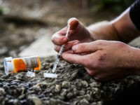 PHILADELPHIA, PA - JULY 27: Micheal Rouwhorst, 28, prepares a shot of heroin and cocaine near the train tracks along E Tusculum St on Thursday, July 27, 2017, in Philadelphia, PA. (Photo by Salwan Georges/The Washington Post via Getty Images)