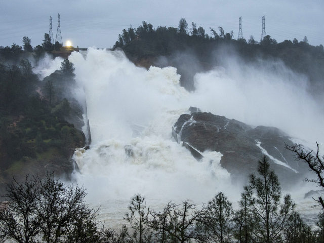 OROVILLE, CA - FEBRUARY 17: In this handout provided by the California Department of Water Resources (pixel.water.ca.gov), Water continues to move down the damaged spillway at Oroville Dam with an outflow of 80,000 cubic feet per second (cfs) on on February 17, 2017 in Oroville, California. Last weekend overflow waters …