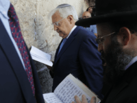 New US ambassador to Israel David Friedman (C) and Rabbi Shmuel Rabinovitch (R) pray at the Western Wall, the holiest site where Jews can pray, in the old city of Jerusalem on May 15, 2017. Controversial new US ambassador to Israel David Friedman arrived in the country to take up his post, days ahead of a visit by US President Donald Trump. / AFP PHOTO / Menahem KAHANA (Photo credit should read MENAHEM KAHANA/AFP/Getty Images)
