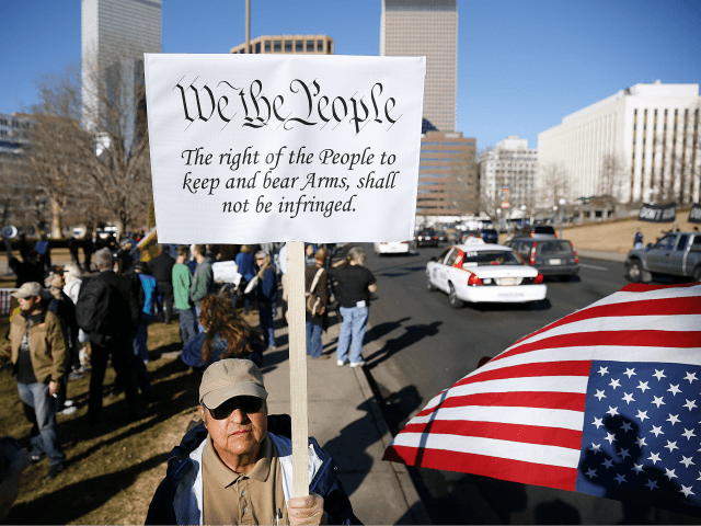 DENVER, CO - JANUARY 9: Second Amendment activist Joseph Gabriele of Littleton, Colorado gathers with other activists in support of gun ownership on January 9, 2013 at the Colorado State Capitol in Denver, Colorado. Lawmakers are calling for tougher gun legislation after recent mass shootings at an Aurora, Colorado movie …