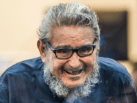 Shining Path leftist guerrilla group leader Abimael Guzman arrives to his trial at a military base in Callao, outskirts of Lima on February 28, 2017, together with twelve other leaders accused of a variety of charges from terrorism to drug trafficking. The jailed leader of Peruvian rebel group Shining Path, …
