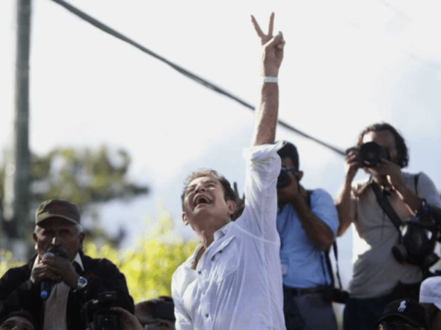 Opposition candidate Salvador Nasralla, who is calling for a re-do of the election, greets supporters during a march near the institute where election ballots are stored in Tegucigalpa, Honduras, Sunday, Dec. 3, 2017. Residents of Honduras' capital are bracing for more demonstrations after a night of pot-banging protests over the …