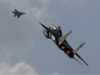 In this Wednesday, Nov. 8, 2017 photo Two Israeli air force F-15s of the Knights of the twin tail 133 squadron fly over Ovda airbase near Eilat, southern Israel, during the 2017 Blue Flag exercise. Israel's military is holding the largest ever air drill of its kind with pilots from eight countries simulating combat scenarios. It said Thursday that Germany, India and France are taking part for the first time in the two week drill codenamed