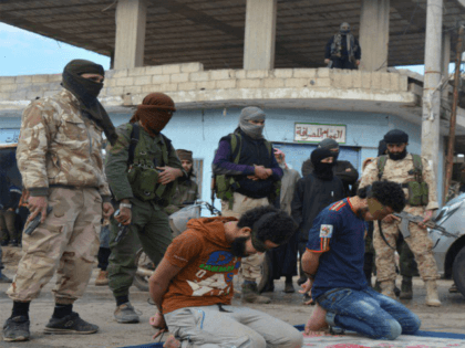 Graphic Photos: Islamic State Partner Executes Three Syrian Civilians Accused of Cooperating With Opposition