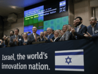 Israeli Prime Minister Benjamin Netanyahu, center right, takes part in a welcome ceremony for him at the London Stock Exchange in the City of London, Friday, Nov. 3, 2017. (AP Photo/Matt Dunham)