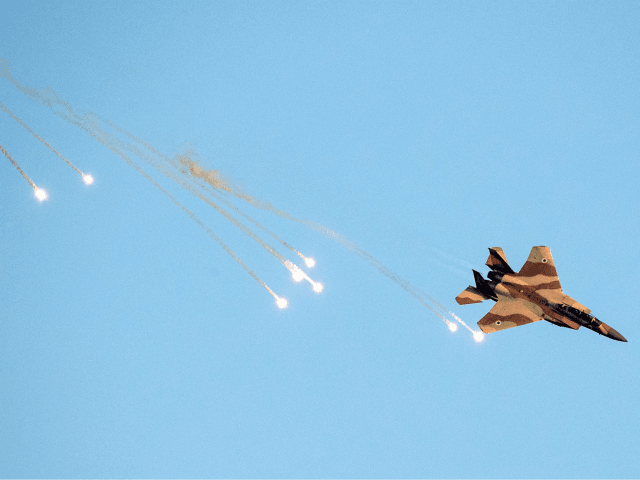 An Israeli F-15 I fighter jet launches anti-missile flares during an air show at the graduation ceremony of Israeli air force pilots at the Hatzerim base in the Negev desert, near the southern Israeli city of Beer Sheva, on June 30, 2016. / AFP / JACK GUEZ (Photo credit should …