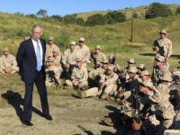 Defense Secretary Jim Mattis talks to U.S. Marine Corps troops at a rifle range at Guantanamo Bay, Cuba, on Thursday, Dec. 21. 2017. The unannounced visit was the first by a defense secretary since Donald Rumsfeld visited in January 2002 shortly after the first prisoners arrived from Afghanistan. (AP Photo/Robert Burns)