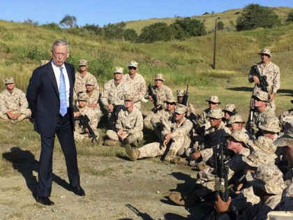 Defense Secretary Jim Mattis talks to U.S. Marine Corps troops at a rifle range at Guantanamo Bay, Cuba, on Thursday, Dec. 21. 2017. The unannounced visit was the first by a defense secretary since Donald Rumsfeld visited in January 2002 shortly after the first prisoners arrived from Afghanistan. (AP Photo/Robert …