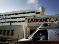 NAHARIYA, ISRAEL - AUGUST 03: An ambulance driver waits in front of the emergency room of the Nahariya hospital August 3, 2006 in Nahariya, Israel. On July 28th a Hezbollah missile landed on the fourth floor crippling a wing of the Nahariya hospital. Patients were moved to its bomb-proof basement …