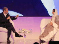 In this Friday, Dec. 15, 2017 photo released by Saudi Arabia Center for International Communication, Ministry of Culture and Information, John Travolta, left, talks at the Apex Convention Center in Riyadh, Saudi Arabia. (Center for International Communication, Ministry of Culture and Information via AP)