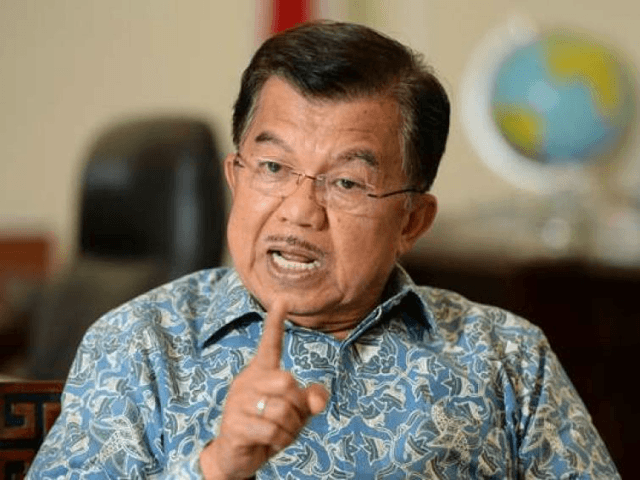 Jusuf Kalla, Indonesia's vice president, gestures as he speaks during an interview at his office in Jakarta, Indonesia, on Tuesday, Dec. 1, 2015. Kalla stepped up pressure on Bank Indonesia to cut interest rates to create jobs and boost economic growth, saying the authority was legally obliged to listen to …