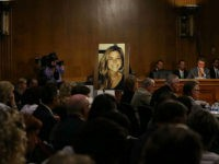 WASHINGTON, DC - JULY 21: A large photo of Kathryn 'Kate' Steinle who was killed by an illegal immigrant in San Francisco, is shown while her dad Jim Steinle testifies during a Senate Judiciary Committee hearing on Capitol Hill, July 21, 2015 in Washington, DC. The committee heard testimony from …