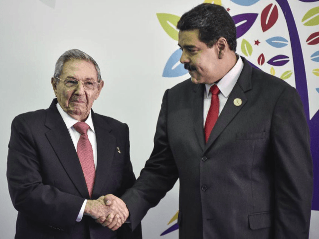 Nicolas Maduro, president of Venezuela, right, and Raul Castro, president of Cuba, shake hands during the Non-Aligned Movement (NAM) Summit in Margarita, Venezuela, on Saturday, Sept. 17, 2016. Venezuela on Tuesday kicked off the the 17th summit of the Non-Aligned Movement on Margarita Island as it attempts to divert attention …