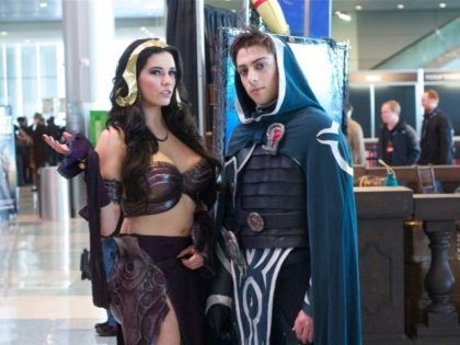 two cosplayers show off their costumes of Magic: the Gathering characters