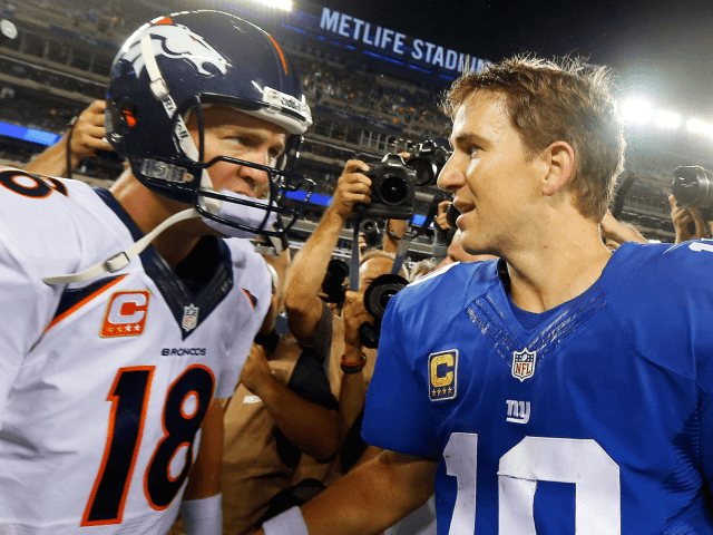 EAST RUTHERFORD, NJ - SEPTEMBER 15: (NEW YORK DAILIES OUT) Quarterbacks Peyton Manning #18 of the Denver Broncos and Eli Manning #10 of the New York Giants meet after their game on September 15, 2013 at MetLife Stadium in East Rutherford, New Jersey. The Broncos defeated the Giants 41-23. (Photo …