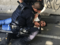 In this image taken from video made available by Lachlan V, an afghan refugee is held by police after a car was driven into pedestrians on a busy Melbourne intersection in Melbourne, Australia Thursday Dec. 21, 2017. Australian police said two men have been arrested after a car was deliberately …