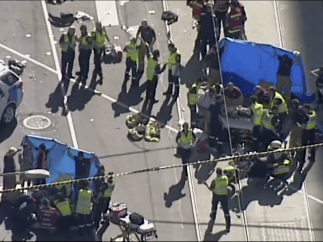 In this photo made video from the Australian Broadcasting Corp., emergency medical workers offer aid to victims struck by a vehicle, Thursday, Dec. 21, 20217, in Melbourne, Australia. Local media say over a dozen people have been injured after a car drove into pedestrians on a sidewalk in central Melbourne. …