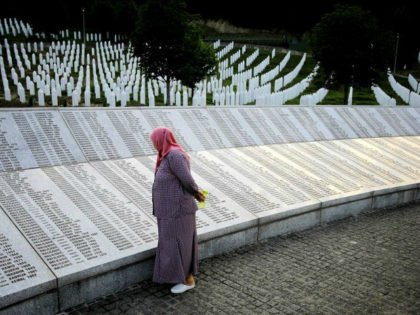 SREBRENICA, BOSNIA AND HERZEGOVINA - JULY 11: A woman reads name of the victims on the memorial at the Potocari Memorial Cemetery, in Srebrenica, Bosnia and Herzegovina on the 22nd anniversary of the Srebrenica genocide, July 11, 2017 after a burial ceremony. Every year on July 11, newly identified victims …