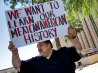 Carlos Galindo protests outside the Arizona Department of Education in Phoenix in 2011. State lawmakers voted in 2010 to ban ethnic studies. (Matt York / Associated Press)