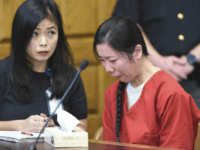 Mingming Chen, right, attends a hearing where her defense attorney argued that a police interview in which Chen acknowledged killing her 5-year-old daughter should be excluded from the Chinese woman's murder trial because a translator wasn't present, on Monday, Oct. 16, 2017, in Stark County Common Pleas Court in Canton, Ohio. Chen, of Jackson Township, Ohio, pleaded not guilty by reason of insanity Thursday, Oct. 12, 2017, in the death of Ashley Zhao, whose body was found hidden in the family's North Canton, Ohio, restaurant on Jan. 10, 2017, a day after she was reported missing. Chen cried as portions of a police interview were played Monday, Oct. 16, 2017, on a projection screen in the courtroom. (Michael Balash/The Canton Repository via AP)