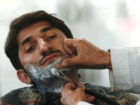 An Afgan man has his beard shaved at the Fazal Mohammad Barber Shop March 4, 2003 in Kabul, Afghanistan. The trimming of beards has become fashionable and a sign of freedom. It was once it was outlawed under the Taliban rule. (Photo by Darren McCollester/Getty Images)