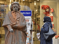 A covered Muslim woman passes a statue of composer Ludwig van Beethoven in the city of Bonn, Germany, Tuesday, Jan. 12, 2016. New Year's Eve sexual assaults and robberies in Cologne and elsewhere were blamed largely on foreigners and pushed the discussion about migrants and their relationship to women's rights. …