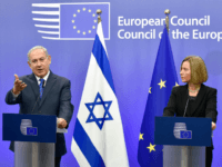 BELGIUM-EU-ISRAEL-DIPLOMACY Israel's Prime Minister Benjamin Netanyahu speaks as EU foreign policy chief, Federica Mogherini looks on during a press conference at the European Council in Brussels on December 11, 2017. Israeli Prime Minister Benjamin Netanyahu is ?holding talks on December 11 with EU foreign ministers, days after the US decision to recognise Jerusalem as Israel's capital, a move the premier had long sought but which has been met by widespread condemnation. / AFP PHOTO / JOHN THYS (Photo credit should read JOHN THYS/AFP/Getty Images)