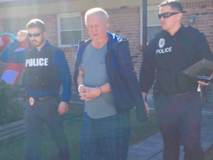 Slidell police released this photo of Michael Neu being taken into custody.