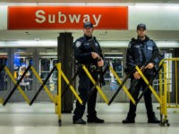 Police stand guard inside the Port Authority Bus Terminal following an explosion near Times Square on Monday, Dec. 11, 2017, in New York. Police said a man with a pipe bomb strapped to his body set off the crude device in a passageway under 42nd Street between Seventh and Eighth …