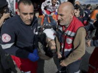 Palestinian paramedics evacuate a wounded protester who wears what looks like a suicide belt during clashes with Israeli troops following protests against U.S. President Donald Trump's decision to recognize Jerusalem as the capital of Israel, in the West Bank city of Ramallah, Friday, Dec. 15, 2017. The man was shot …