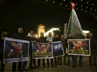 Palestinian hold posters of the U.S. President Donald Trump during a protest in Bethlehem, West Bank, Tuesday, Dec. 6, 2017. President Trump forged ahead Tuesday with plans to recognize Jerusalem as Israel's capital despite intense Arab, Muslim and European opposition to a move that would upend decades of U.S. policy and risk potentially violent protests. (AP Photo/Mahmoud Illean)