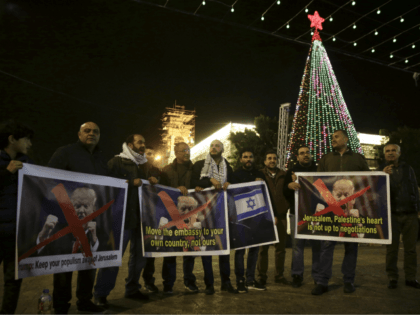 Palestinian hold posters of the U.S. President Donald Trump during a protest in Bethlehem, West Bank, Tuesday, Dec. 6, 2017. President Trump forged ahead Tuesday with plans to recognize Jerusalem as Israel's capital despite intense Arab, Muslim and European opposition to a move that would upend decades of U.S. policy …