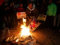 Palestinian demonstrators burn posters of the US president in Bethlehem's Manger Square in protest to him declaring Jerusalem as Israel's capital on December 6, 2017. Abbas said the United States can no longer play the role of peace broker after Donald Trump's decision on Wednesday to recognise Jerusalem as Israel's …