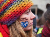 BONN, NORTH RHINE-WESTPHALIA, GERMANY - 2017/11/04: 'Planet Earth First' written on a girl's face. With the motto 'keep coal in the ground' thousands of activists took to the streets demanding Climate Justice two days ahead of the United Nations Framework Convention on Climate Change - UNFCCC - COP23. (Photo by …