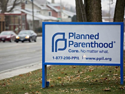 Signage is displayed outside a Planned Parenthood office in Peoria, Illinois, U.S., on Friday, Dec. 16, 2016. Republicans are thinking ahead to regulations Obama might still try to complete before he leaves office, including a pending rule barring states from blocking funds to Planned Parenthood. Photographer: Daniel Acker/Bloomberg via Getty …