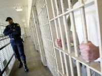 ** ADVANCE FOR WEEKEND, FEB. 5-6 ** Washington state prisons Lt. Clan Jacobs, left, walks through a block of cells at the Washington Corrections Center in Shelton, Wash., Wednesday, Feb. 2, 2005. The prison is the most crowded in the badly crowded state system, and many of the two-bunk cells …