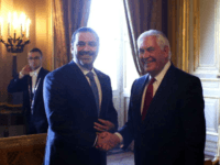 Lebanon's Prime Minister Saad Hariri, left, shakes hands with U.S. Secretary of State Rex Tillerson gathering of world diplomats in Paris, Friday, Dec. 8, 2017. It's the first major gathering of key nations to discuss Lebanon's future since a crisis erupted following Hariri's resignation while in Saudi Arabia. (AP Photo/Thibault …